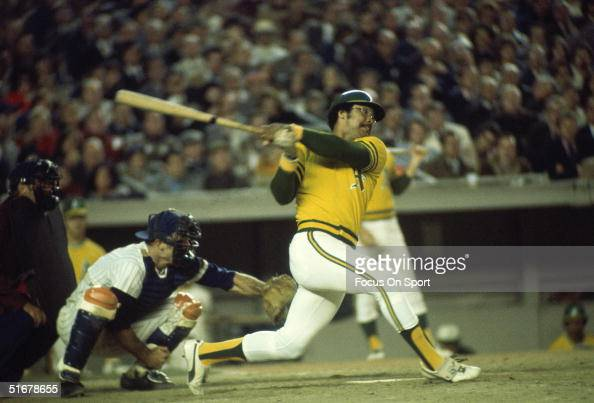 Reggie Jackson of the Oakland Athletics swats the ball during the World Series against the New York Mets at Shea Stadium on October 1973 in Flushing...