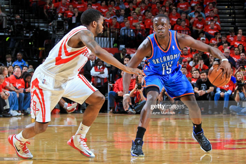 Reggie Jackson #15 of the Oklahoma City Thunder advances the ball against Aaron Brooks #0 of the Houston Rockets in Game Six of the Western Conference Quarterfinals during the 2013 NBA Playoffs on May 3, 2013 at the Toyota Center in Houston, Texas.