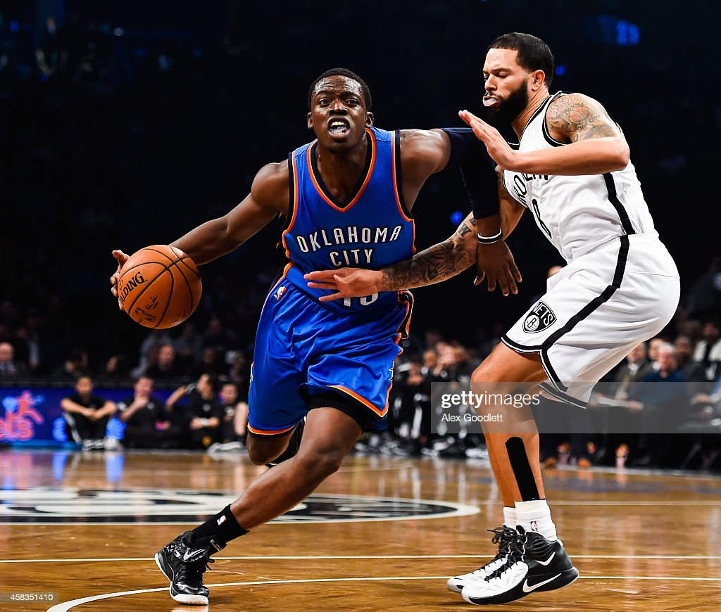 Reggie Jackson of the Oklahoma City Thunder attempts to dribble past Deron Williams of the Brooklyn Nets in the first quarter at the Barclays Center...