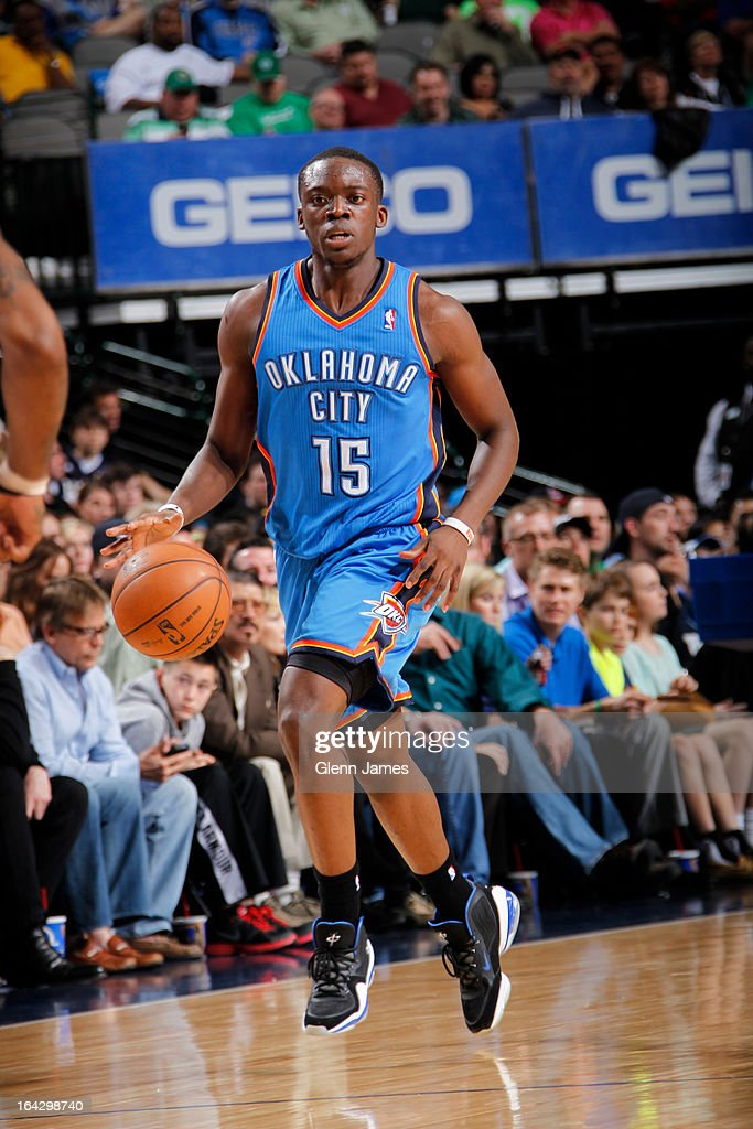 Reggie Jackson #15 of the Oklahoma City Thunder brings the ball up court against the Dallas Mavericks on March 17, 2013 at the American Airlines Center in Dallas, Texas.