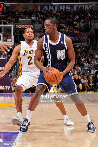 Reggie Jackson of the Oklahoma City Thunder controls the ball against Chris Duhon of the Los Angeles Lakers at Staples Center on January 27 2013 in...