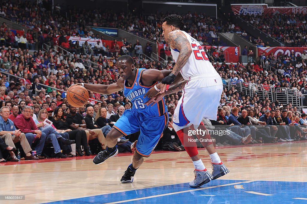 Reggie Jackson #15 of the Oklahoma City Thunder dribbles against Matt Barnes #22 of the Los Angeles Clippers at Staples Center on March 3, 2013 in Los Angeles, California.