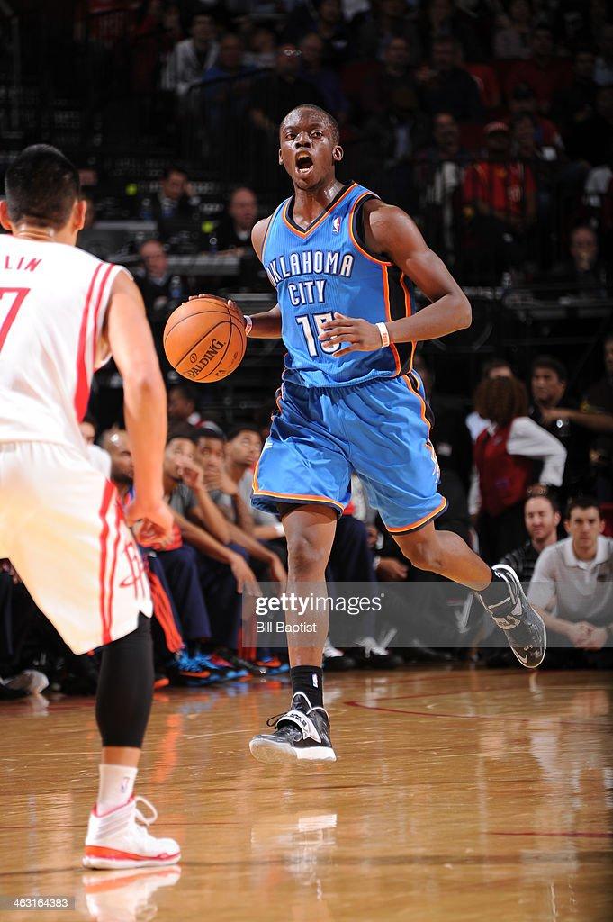 Reggie Jackson #15 of the Oklahoma City Thunder dribbles the ball against the Houston Rockets on January 16, 2014 at the Toyota Center in Houston, Texas.