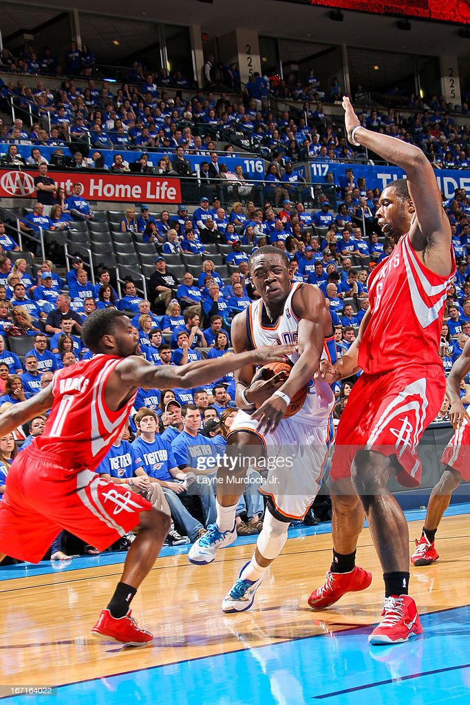 Reggie Jackson #15 of the Oklahoma City Thunder drives against Aaron Brooks #0 and Terrence Jones #6 of the Houston Rockets in Game One of the Western Conference Quarterfinals during the 2013 NBA playoffs on April 21, 2013 at the Chesapeake Energy Arena in Oklahoma City, Oklahoma.
