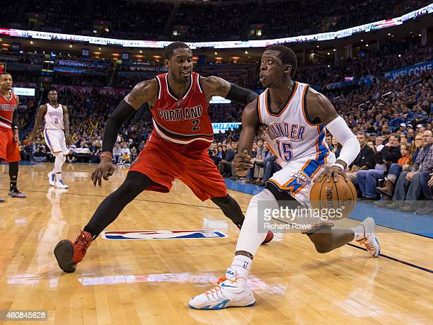 Reggie Jackson of the Oklahoma City Thunder drives against Wesley Matthews of the Portland Trail Blazers at the Chesapeake Energy Arena on December...