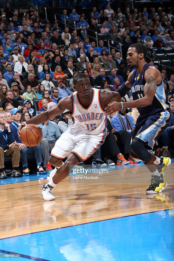 Reggie Jackson #15 of the Oklahoma City Thunder drives baseline against Mike Conley #11 of the Memphis Grizzlies during an NBA game on January 31, 2013 at the Chesapeake Energy Arena in Oklahoma City, Oklahoma.