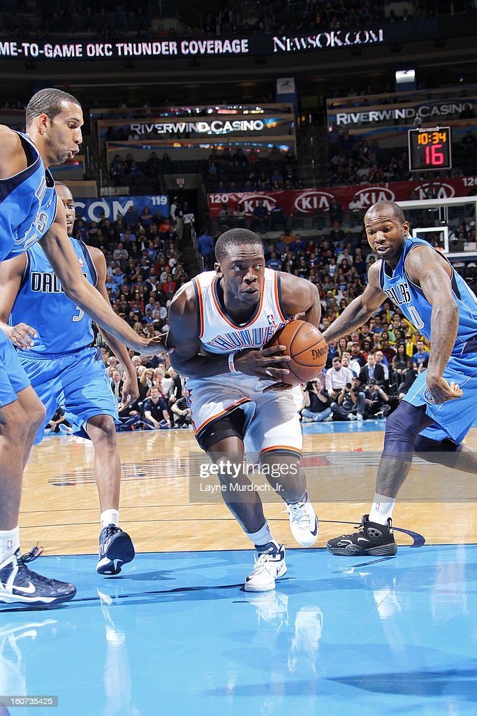 Reggie Jackson #15 of the Oklahoma City Thunder drives to the basket against <a gi-track='captionPersonalityLinkClicked' href=/galleries/search?phrase=Brandan+Wright&family=editorial&specificpeople=3847557 ng-click='$event.stopPropagation()'>Brandan Wright</a> #34 and <a gi-track='captionPersonalityLinkClicked' href=/galleries/search?phrase=Dominique+Jones+-+Basketball+Player&family=editorial&specificpeople=4782614 ng-click='$event.stopPropagation()'>Dominique Jones</a> #20 of the Dallas Mavericks on February 04, 2013 at the Chesapeake Energy Arena in Oklahoma City, Oklahoma.