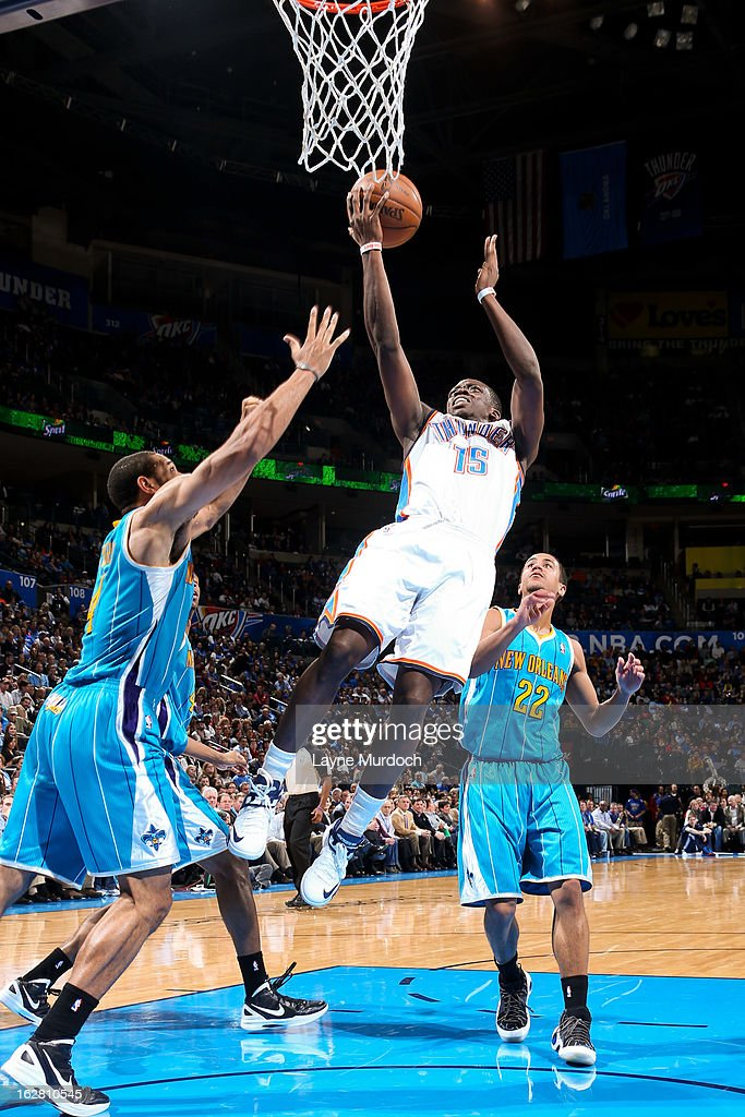 Reggie Jackson #15 of the Oklahoma City Thunder drives to the basket against Brian Roberts #22 and Xavier Henry #4 of the New Orleans Hornets on February 27, 2013 at the Chesapeake Energy Arena in Oklahoma City, Oklahoma.