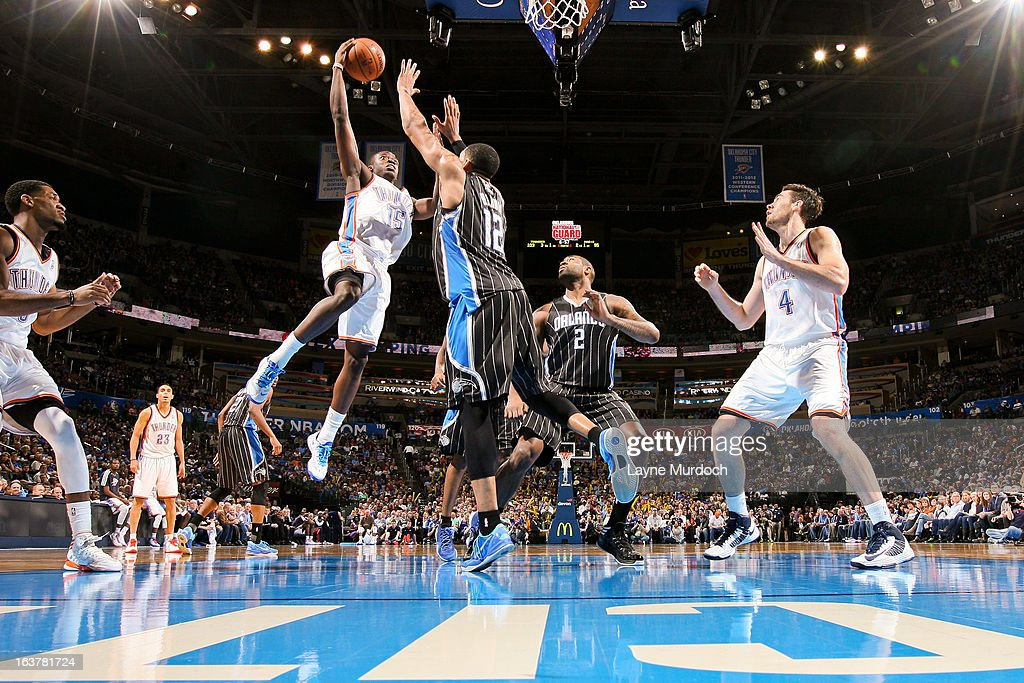 Reggie Jackson #15 of the Oklahoma City Thunder drives to the basket against <a gi-track='captionPersonalityLinkClicked' href=/galleries/search?phrase=Tobias+Harris&family=editorial&specificpeople=6902922 ng-click='$event.stopPropagation()'>Tobias Harris</a> #12 of the Orlando Magic on March 15, 2013 at the Chesapeake Energy Arena in Oklahoma City, Oklahoma.