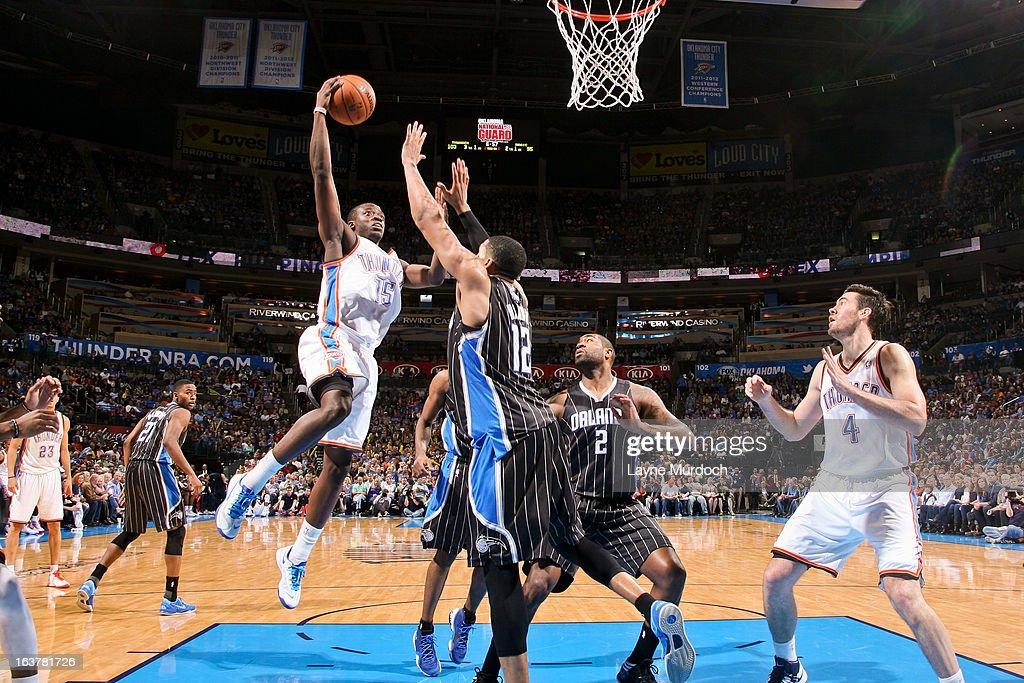 Reggie Jackson #15 of the Oklahoma City Thunder drives to the basket against Tobias Harris #12 of the Orlando Magic on March 15, 2013 at the Chesapeake Energy Arena in Oklahoma City, Oklahoma.