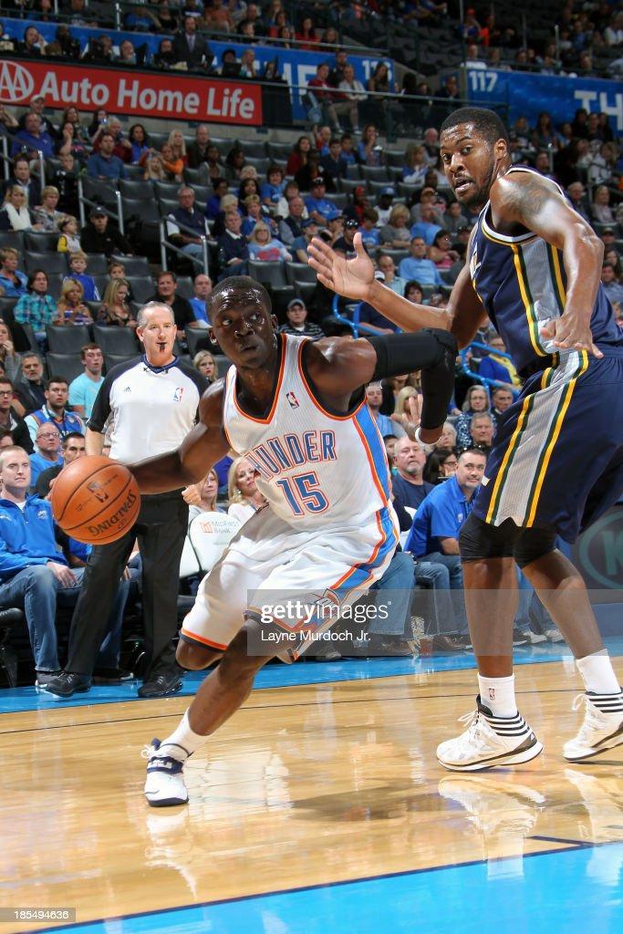 Reggie Jackson #15 of the Oklahoma City Thunder drives to the basket against the Utah Jazz during an NBA preseason game on October 20, 2013 at the Chesapeake Energy Arena in Oklahoma City, Oklahoma.