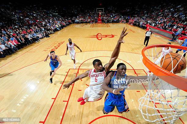 Reggie Jackson of the Oklahoma City Thunder drives to the basket against the Houston Rockets on January 16 2014 at the Toyota Center in Houston Texas...