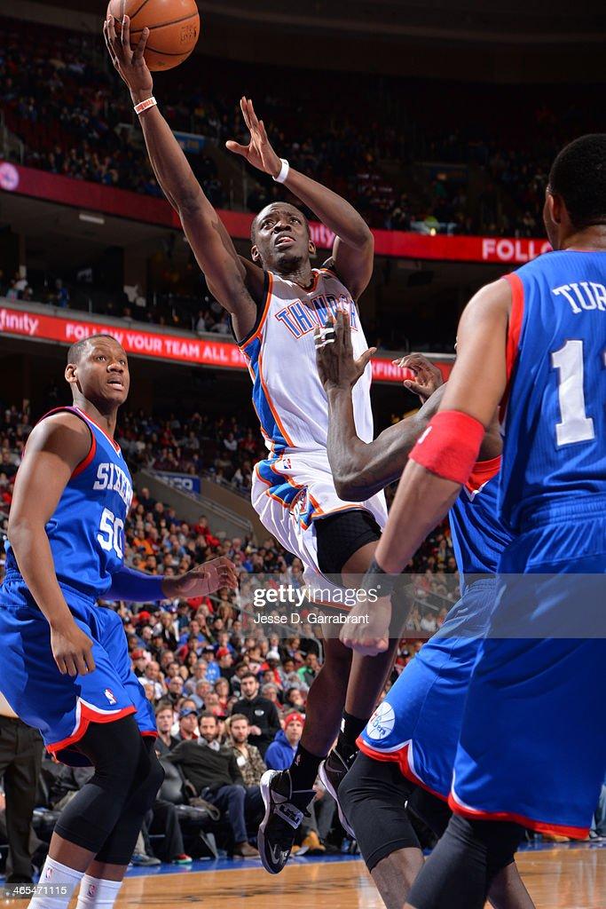 Reggie Jackson #15 of the Oklahoma City Thunder drives to the basket against the Philadelphia 76ers at the Wells Fargo Center on January 25, 2014 in Philadelphia, Pennsylvania.