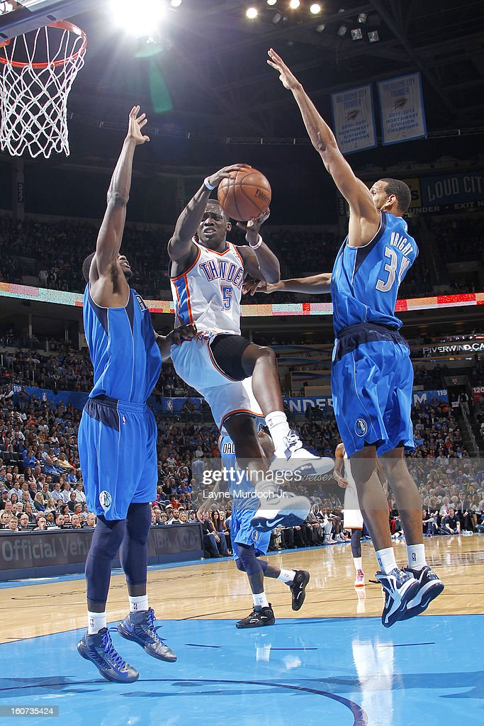 Reggie Jackson #15 of the Oklahoma City Thunder goes to the basket against <a gi-track='captionPersonalityLinkClicked' href=/galleries/search?phrase=Bernard+James&family=editorial&specificpeople=7387529 ng-click='$event.stopPropagation()'>Bernard James</a> #5 and <a gi-track='captionPersonalityLinkClicked' href=/galleries/search?phrase=Brandan+Wright&family=editorial&specificpeople=3847557 ng-click='$event.stopPropagation()'>Brandan Wright</a> #34 of the Dallas Mavericks of the Dallas Mavericks on February 04, 2013 at the Chesapeake Energy Arena in Oklahoma City, Oklahoma.