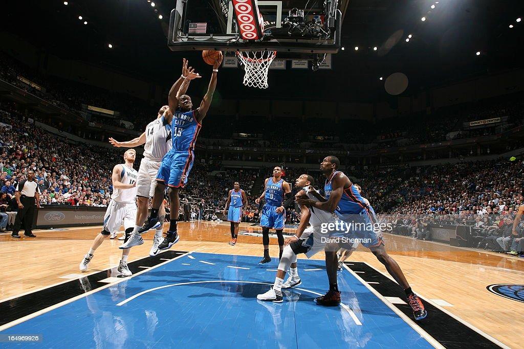 Reggie Jackson #15 of the Oklahoma City Thunder goes to the basket against Nikola Pekovic #14 of the Minnesota Timberwolves on March 29, 2013 at Target Center in Minneapolis, Minnesota.