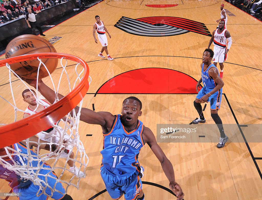 Reggie Jackson #15 of the Oklahoma City Thunder grabs a rebound against the Portland Trail Blazers on January 13, 2013 at the Rose Garden Arena in Portland, Oregon.