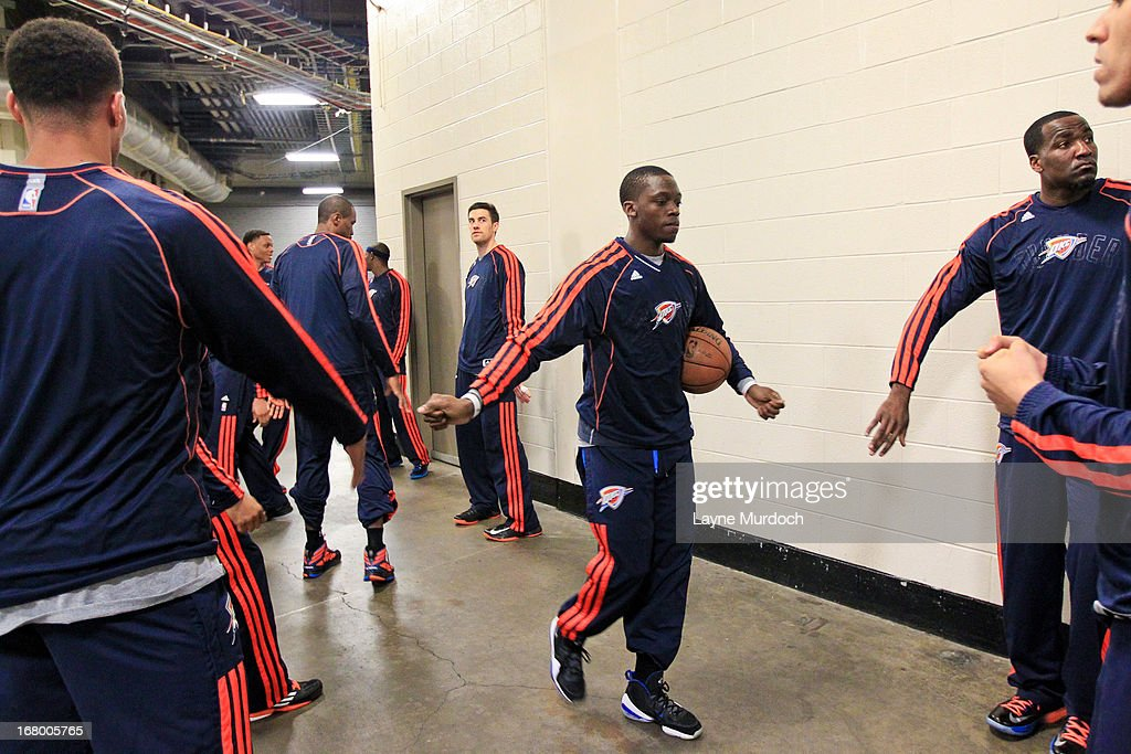 Reggie Jackson #15 of the Oklahoma City Thunder greets teammates before playing against the Houston Rockets in Game Six of the Western Conference Quarterfinals during the 2013 NBA Playoffs on May 3, 2013 at the Toyota Center in Houston, Texas.