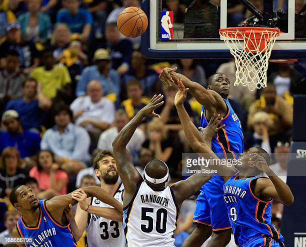 Reggie Jackson of the Oklahoma City Thunder knocks a shot away from Zach Randolph and Marc Gasol of the Memphis Grizzlies during Game Four of the...
