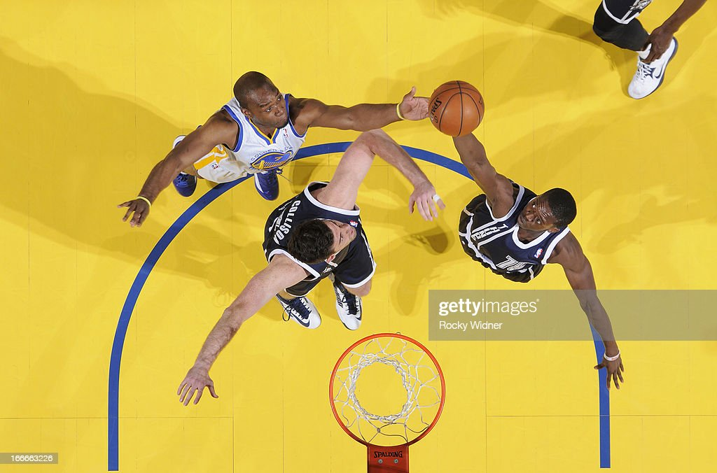 Reggie Jackson #15 of the Oklahoma City Thunder rebounds against <a gi-track='captionPersonalityLinkClicked' href=/galleries/search?phrase=Carl+Landry&family=editorial&specificpeople=4111952 ng-click='$event.stopPropagation()'>Carl Landry</a> #7 of the Golden State Warriors on April 11, 2013 at Oracle Arena in Oakland, California.