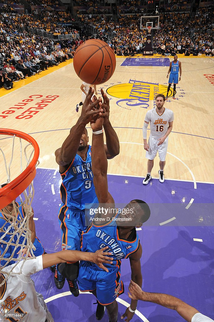 Reggie Jackson #15 of the Oklahoma City Thunder rebounds against the Los Angeles Lakers at STAPLES Center on March 9, 2014 in Los Angeles, California.