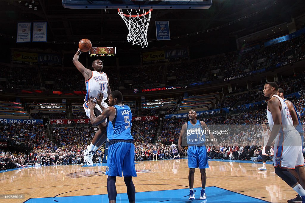 Reggie Jackson #15 of the Oklahoma City Thunder rises for a dunk against Bernard James #5 of the Dallas Mavericks on February 4, 2013 at the Chesapeake Energy Arena in Oklahoma City, Oklahoma.