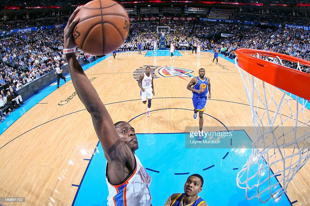 Reggie Jackson #15 of the Oklahoma City Thunder rises for a dunk against <a gi-track='captionPersonalityLinkClicked' href=/galleries/search?phrase=Kent+Bazemore&family=editorial&specificpeople=6846101 ng-click='$event.stopPropagation()'>Kent Bazemore</a> #20 of the Golden State Warriors on February 6, 2013 at the Chesapeake Energy Arena in Oklahoma City, Oklahoma.