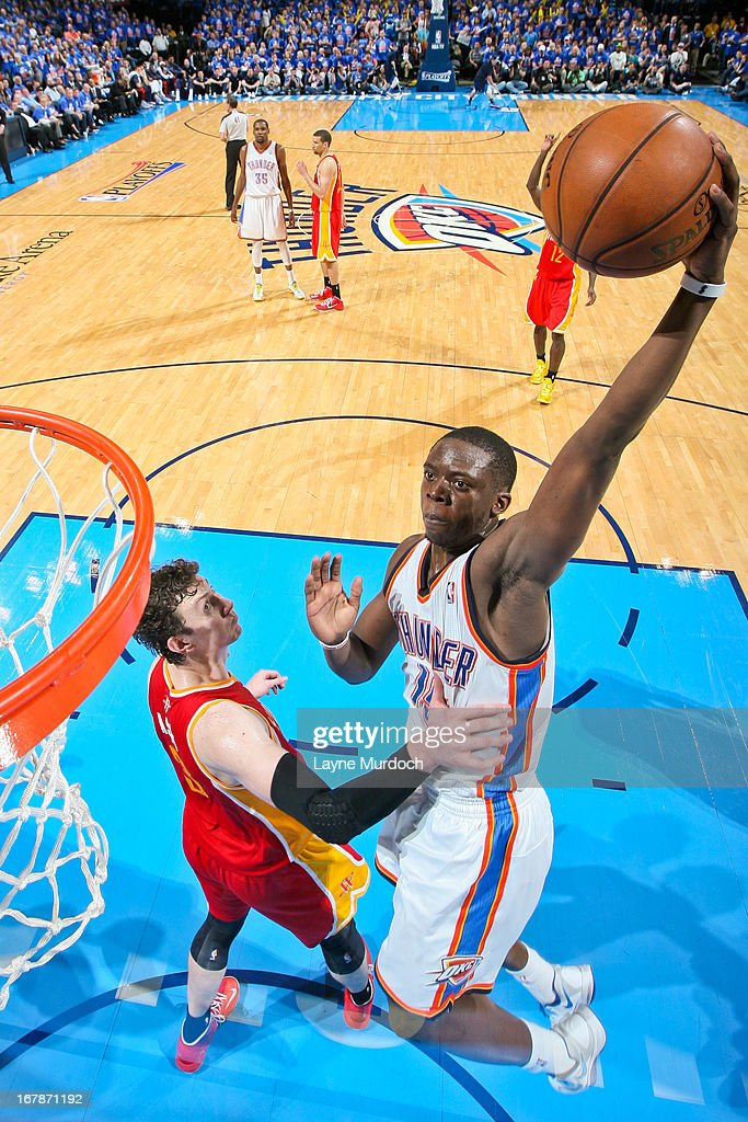 Reggie Jackson #15 of the Oklahoma City Thunder rises for a dunk against Omer Asik #3 of the Houston Rockets in Game Five of the Western Conference Quarterfinals during the 2013 NBA Playoffs on May 1, 2013 at the Chesapeake Energy Arena in Oklahoma City, Oklahoma.