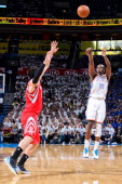 Reggie Jackson of the Oklahoma City Thunder shoots a threepointer against Carlos Delfino of the Houston Rockets in Game Two of the Western Conference...