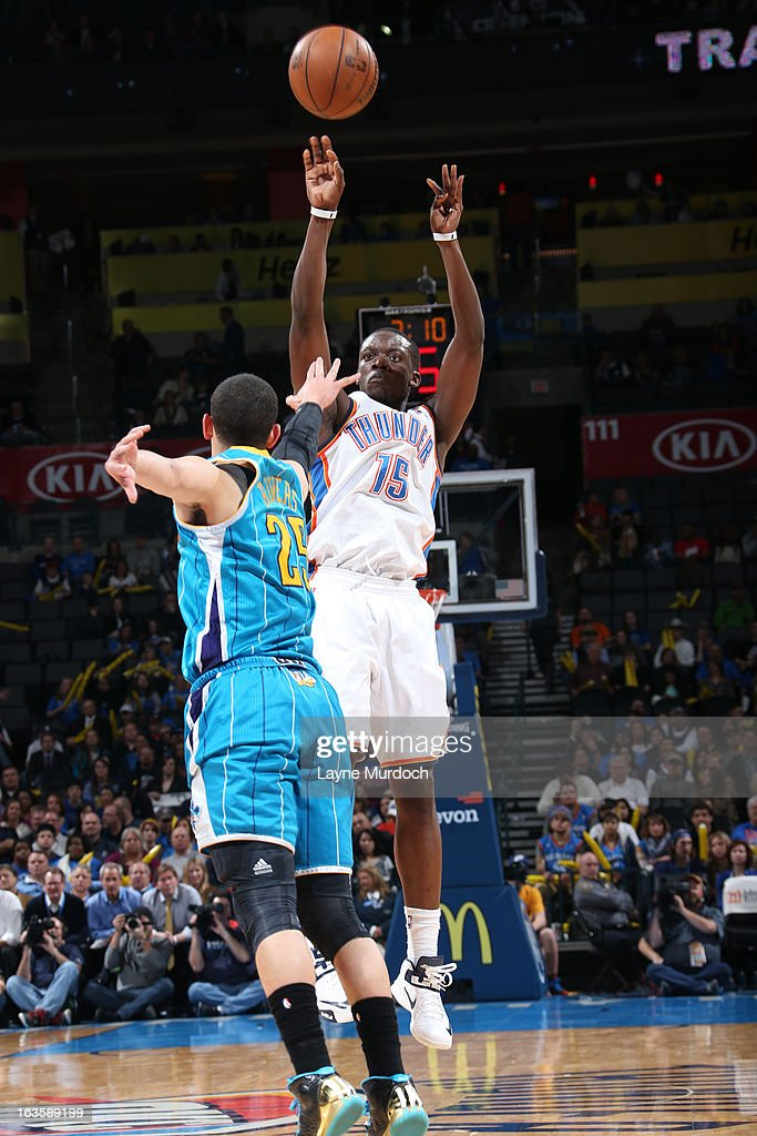Reggie Jackson #15 of the Oklahoma City Thunder shoots against <a gi-track='captionPersonalityLinkClicked' href=/galleries/search?phrase=Austin+Rivers&family=editorial&specificpeople=7117574 ng-click='$event.stopPropagation()'>Austin Rivers</a> #25 of the New Orleans Hornets on February 27, 2013 at the Chesapeake Energy Arena in Oklahoma City, Oklahoma.