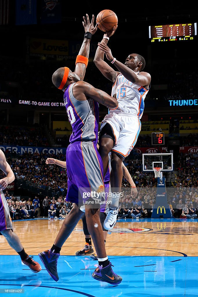 Reggie Jackson #15 of the Oklahoma City Thunder shoots in the lane against Jermaine O'Neal #20 of the Phoenix Suns on February 8, 2013 at the Chesapeake Energy Arena in Oklahoma City, Oklahoma.