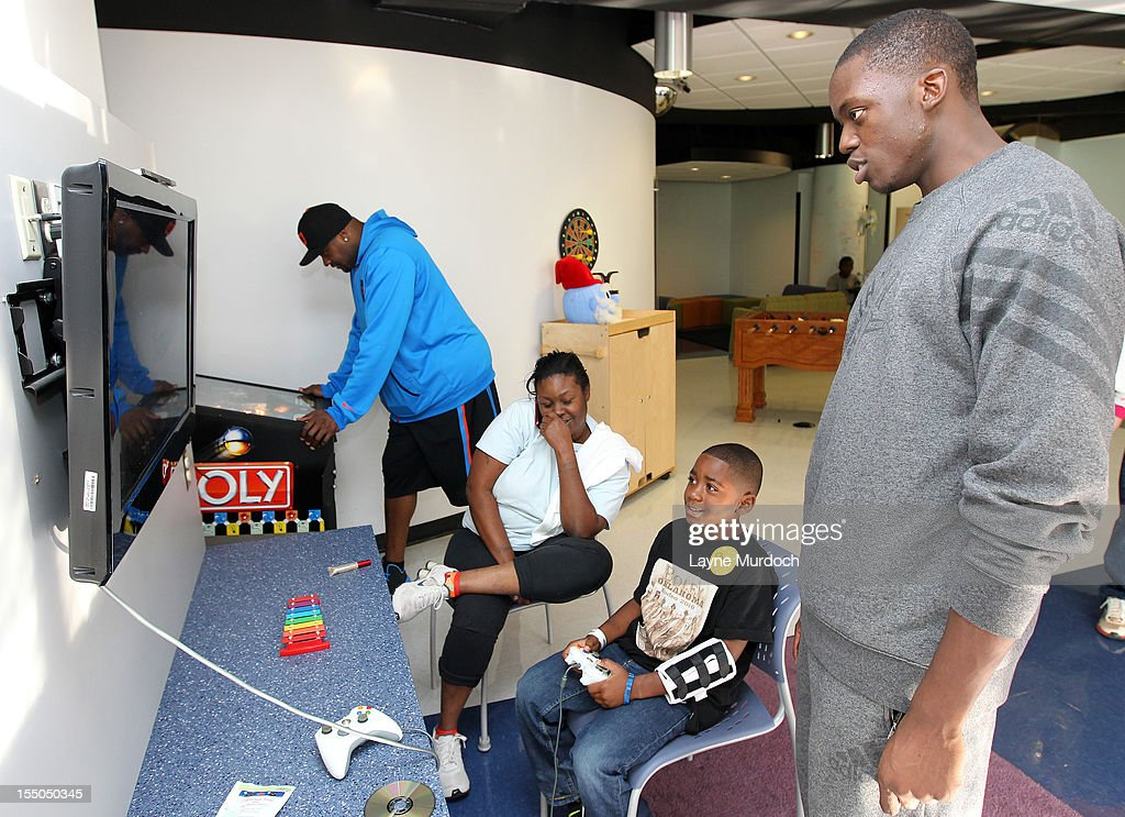 Reggie Jackson of the Oklahoma City Thunder visits patients in the Children's Hospital on October 30, 2012 in Oklahoma City, Oklahoma.