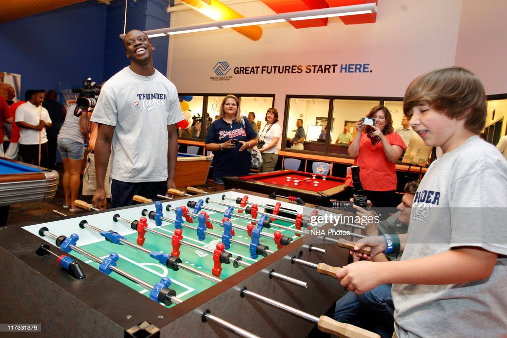 Reggie Jackson, the Oklahoma City Thunder first round draft pick, plays some of the new games at the Boys & Girls Club of Oklahoma County on June 25, 2011 in Oklahoma City, Oklahoma.