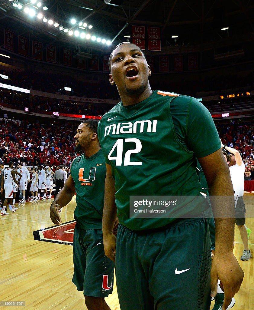 Reggie Johnson #42 of the Miami Hurricanes celebrates after a last-second win over the North Carolina State Wolfpack during play at PNC Arena on February 2, 2013 in Raleigh, North Carolina. Miami won 79-78.