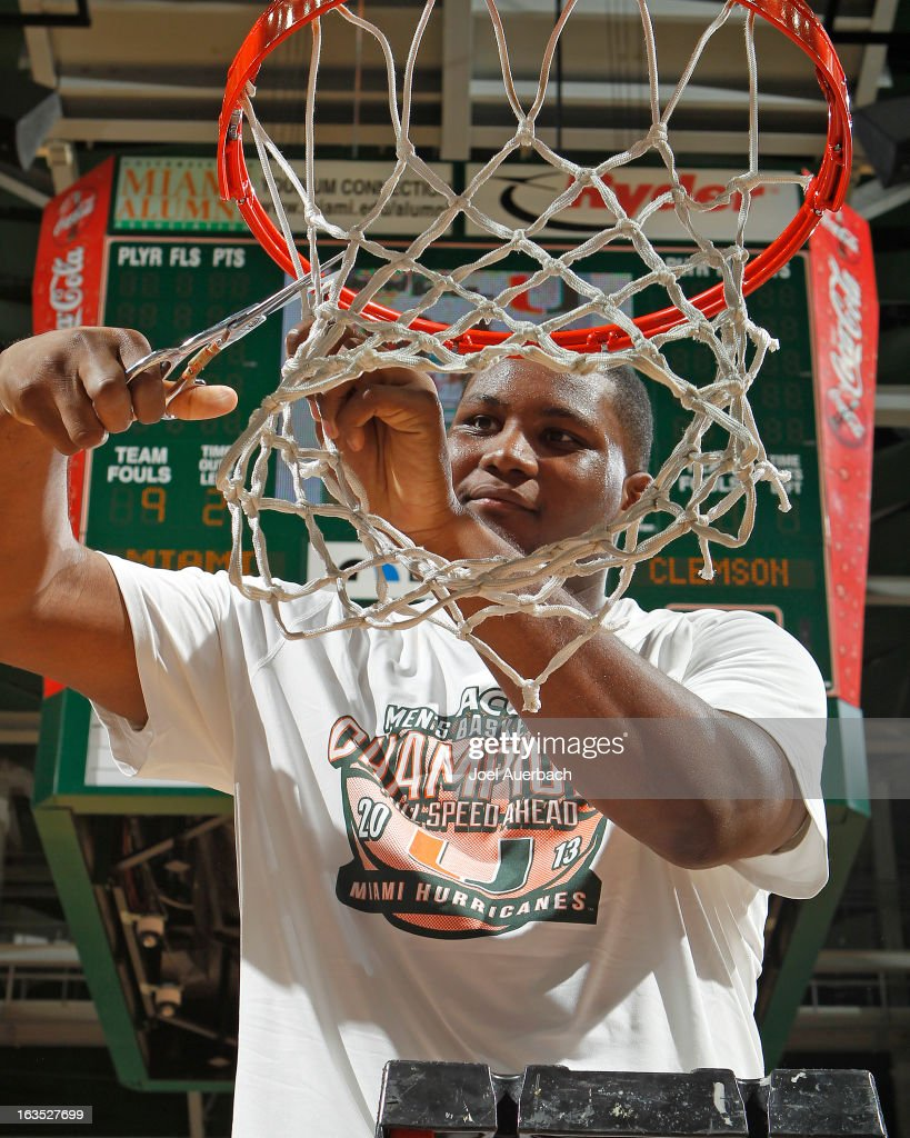 Reggie Johnson #42 of the Miami Hurricanes cuts the net down after the game against the Clemson Tigers on March 9, 2013 at the BankUnited Center in Coral Gables, Florida. The Hurricanes defeated the Tigers 62-49 and won the Atlantic Coast Conference Championship.