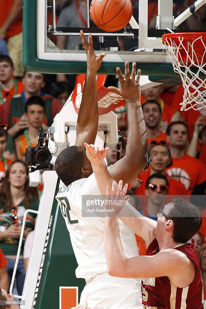 Reggie Johnson #42 of the Miami Hurricanes scores as he is fouled by Andrew Van Nest #15 of the Boston College Eagles on February 5, 2013 at the BankUnited Center in Coral Gables, Florida. The Hurricanes defeated the Eagles 72-50.