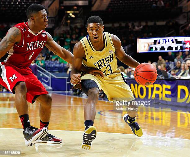 Reggie Johnson of the Miami Redhawks guards as Demetrius Jackson of the Notre Dame Fighting Irish dribbles to the lane at Purcel Pavilion on November...