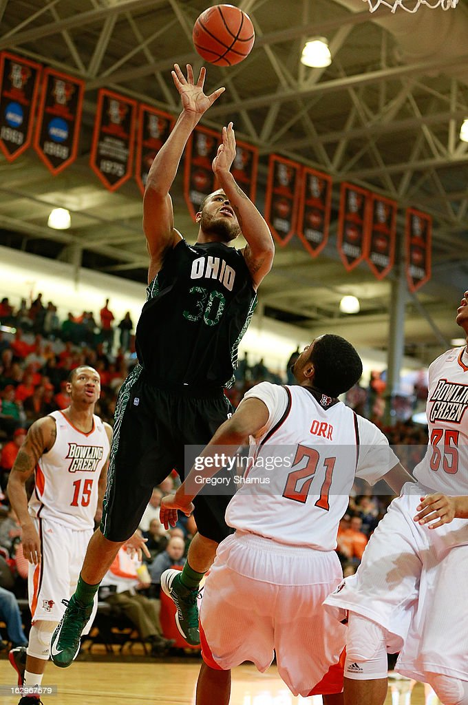Reggie Keely #30 of the Ohio Bobcats takes a second half shot over Chauncey Orr #21 of the Bowling Green Falcons at the Stroh Center on March 2, 2013 in Bowling Green, Ohio. Ohio won the game 78-65.