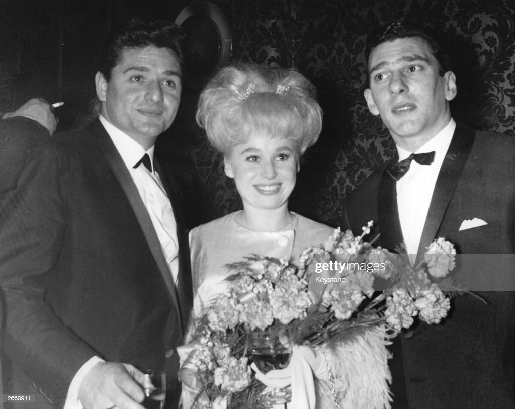 Reggie Kray, right, at a film premiere with actress Barbara Windsor and her husband Ronnie Knight, an associate of the Kray Twins, circa 1969.