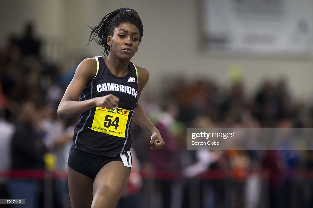Reggie Lewis Center - Maya Halprin-Adams, a junior at Cambridge Rindge and Latin, runs her first-place finish of the 1000 meter run. The Massachusetts Interscholastic Athletic Association (MIAA) Division I Indoor Track and Field Championships were held at the Reggie Lewis Track and Athletic Center on Monday, Feb. 17, 2014.