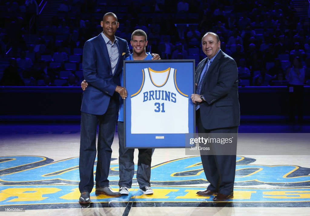 <a gi-track='captionPersonalityLinkClicked' href=/galleries/search?phrase=Reggie+Miller&family=editorial&specificpeople=201590 ng-click='$event.stopPropagation()'>Reggie Miller</a>, Darrell Miller Jr. and UCLA athletic director Dan Guerrero pose during a jersey retirement ceremony for <a gi-track='captionPersonalityLinkClicked' href=/galleries/search?phrase=Reggie+Miller&family=editorial&specificpeople=201590 ng-click='$event.stopPropagation()'>Reggie Miller</a> at Pauley Pavilion on January 30, 2013 in Los Angeles, California.