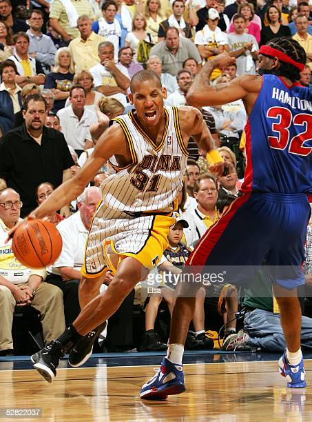 Reggie Miller of the Indiana Pacers drives against Richard Hamilton of the Detroit Pistons in Game three of the Eastern Conference Semifinals during...