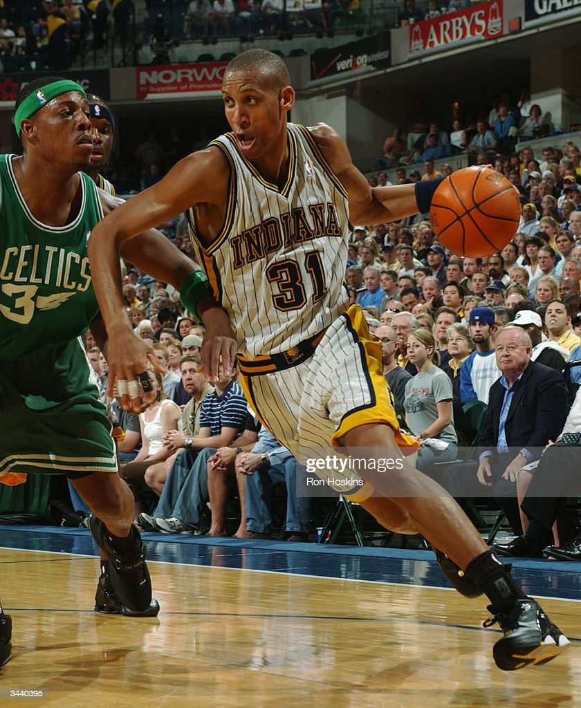 Reggie Miller of the Indiana Pacers drives past Paul Pierce of the Boston Celtics during game one of the Eastern Conference quarter finals April 17...