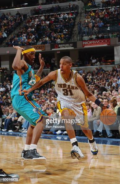 Reggie Miller of the Indiana Pacers drives to the basket against JR Smith of the New Orleans Hornets December 27 2004 at Conseco Fieldhouse in...