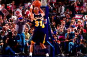 Reggie Miller of the Indiana Pacers shoots a freethrow in Game One of the Eastern Conference Semifinals against the New York Knicks during the 1995...
