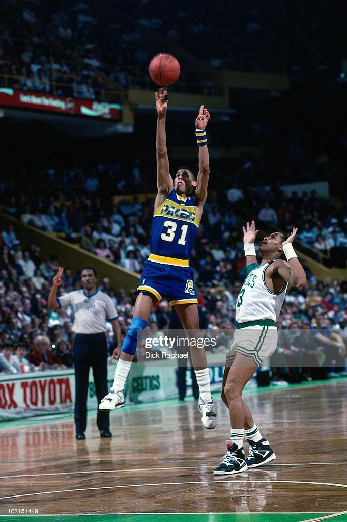 Reggie Miller #31 of the Indiana Pacers shoots a jumper against the Boston Celtics during a game played in 1990 at the Boston Garden in Boston, Massachusetts.