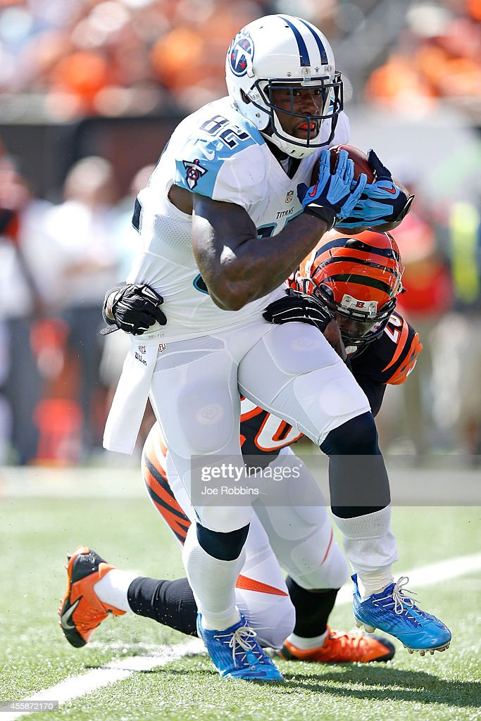 Reggie Nelson of the Cincinnati Bengals attempts to tackle Delanie Walker of the Tennessee Titans during the first quarter at Paul Brown Stadium on...