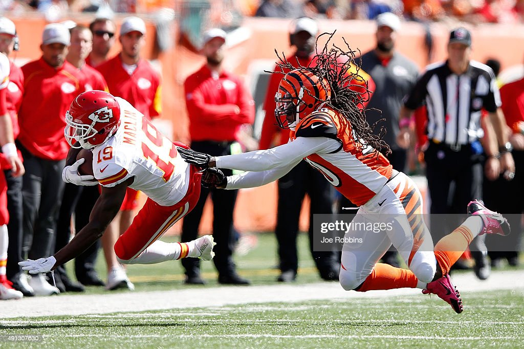 Reggie Nelson of the Cincinnati Bengals knocks down Jeremy Maclin of the Kansas City Chiefs after catching a pass during the second quarter at Paul...