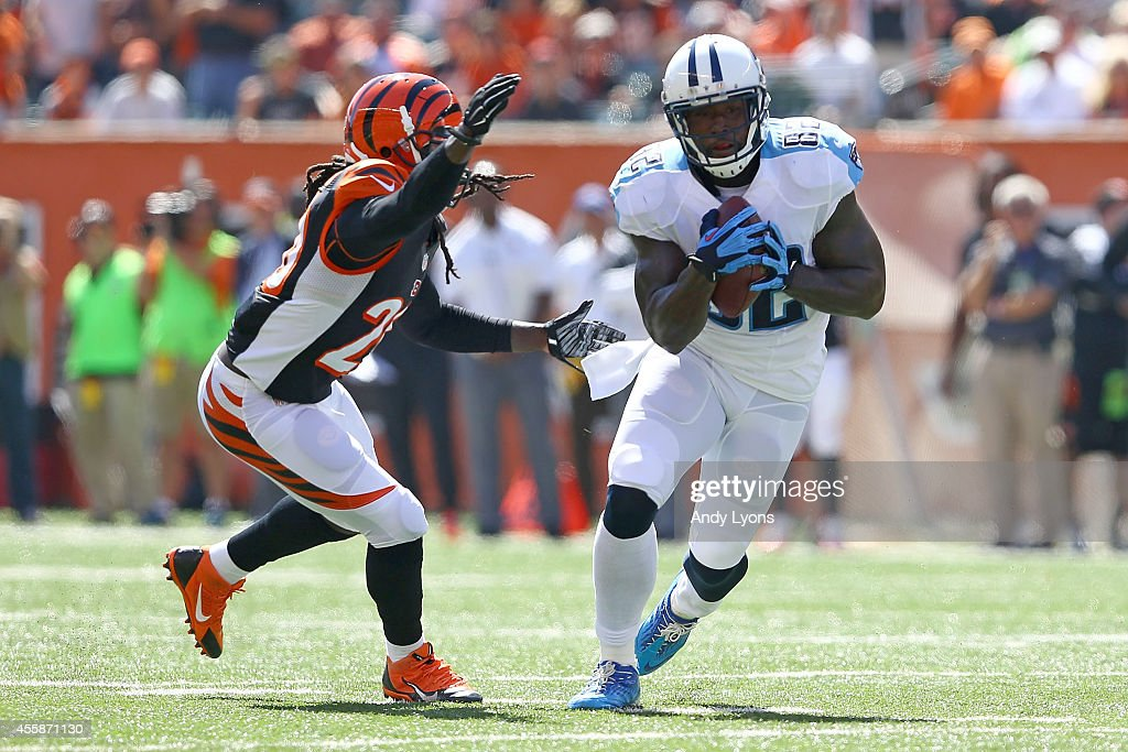 Reggie Nelson of the Cincinnati Bengals tackles Delanie Walker of the Tennessee Titans during the first quarter at Paul Brown Stadium on September 21...
