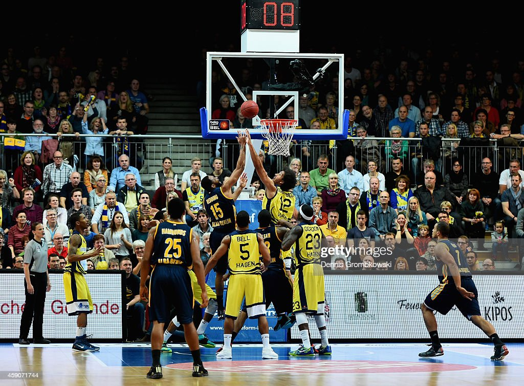 Reggie Redding of ALBA Berlin and Urule Igbavboa of Phoenix Hagen battle for the ball during the Beko BBL Basketball Bundesliga match between Phoenix...