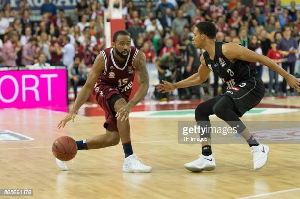 Reggie Redding of Bayern Muenchen and Abdul Gaddy of Wuerzburg battle for the ball during the easyCredit BBL Basketball Bundesliga match between FC...